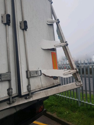 The steel frame of a reefer truck was torn